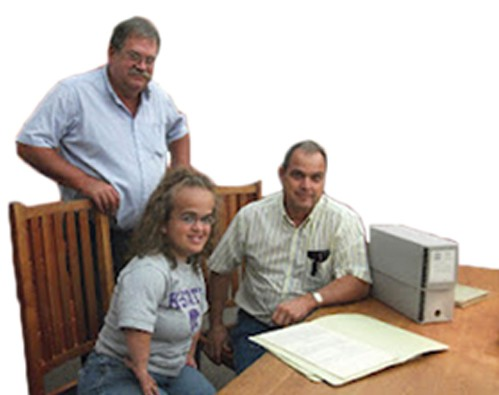 KFU President Donn Teske, at left in photo, and NFU Historian Tom Giessel, at right in photo, Syndee spent two months organizing and making digital copies of valuable historical documents.