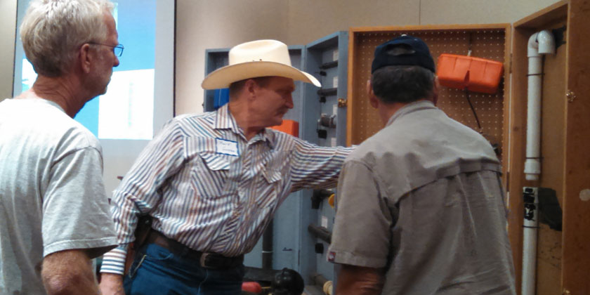 Missouri NRCS specialist Mark Green answers waterer questions following his workshop on electric fencing and livestock watering options in Topeka on September 9.
