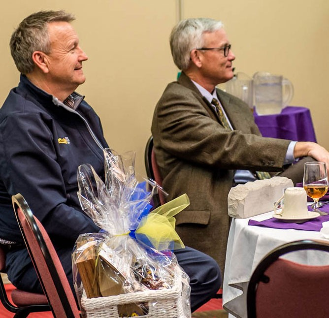 Greg Frank, MRA agent from Smith Center, and Rick Lindblom, MRA District Manager, already win big during the KFUF auction.