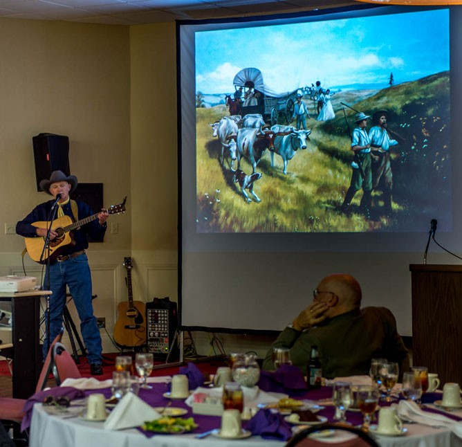 Jeff Davidson sings about the wagon trains across Kansas.