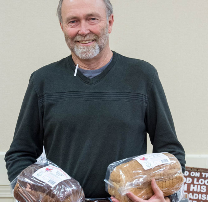 Norm Oeding, KFU member, with his annual Kansas Farmers Union Foundation–bread from his Little Red Hen Bakery.