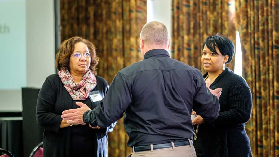 Common Ground's Donna Pearson McClish and Keisha McClish discuss food deserts with an attendee.