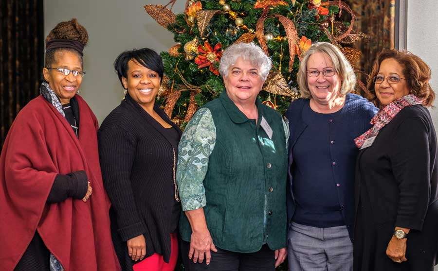 Donna Pearson McClish, founder of Common Ground Producers and Growers of Wichita presented their history and how they deliver fresh fruits and vegetables twice a month to 23 senior citizens centers and food desserts in the Sedgwick County Area. This service allows seniors to use their food coupons to purchase nutritious fresh produce. Their motto is 'All are fed, none are hungry.' Pictured from left, Common Ground members Janet Diggs, and Keisha McClish, along with Mary Howell KFU, Kerri Ebert KSCAAC, and Donna Pearson McClish.