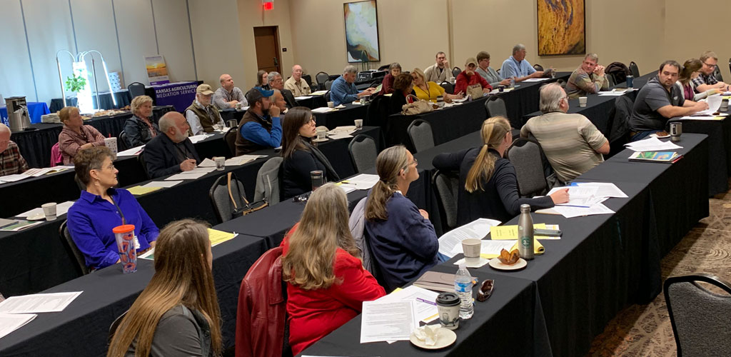 Chapter delegates debating policy at 2019 KFU State Convention.